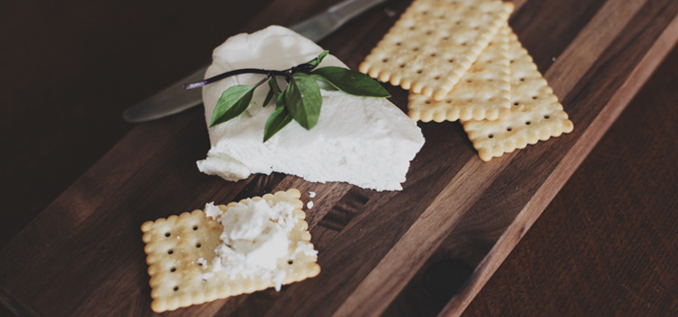 Cream cheese spread on cracker