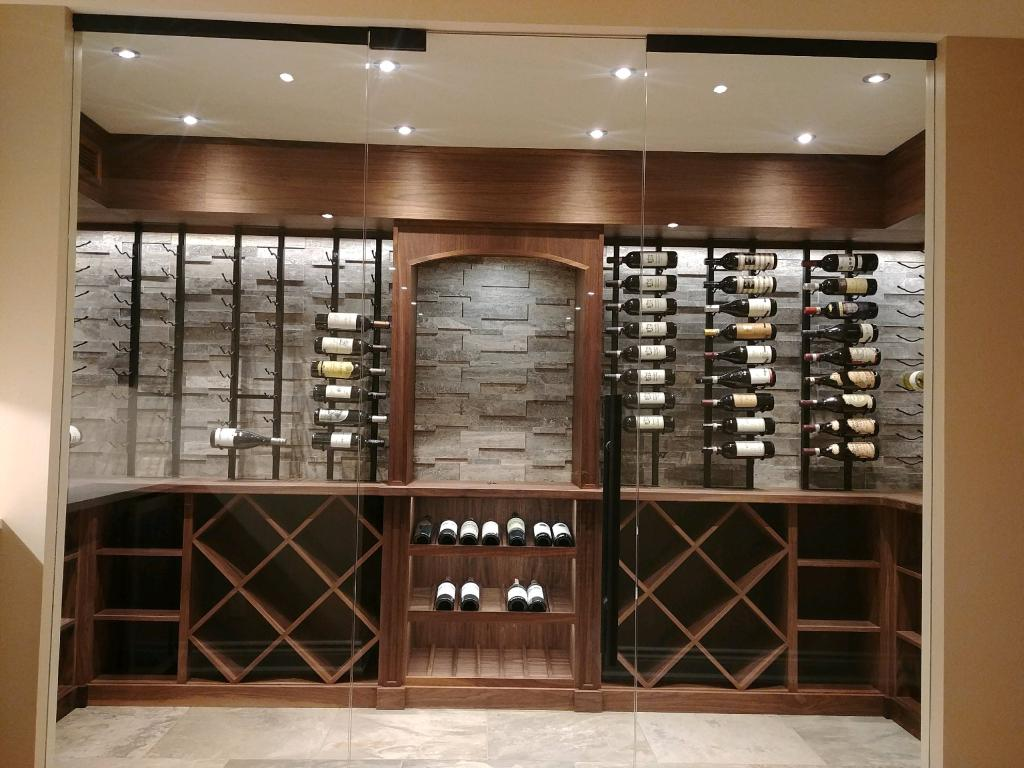 wooden wine racks in glass door wine cellar Toronto