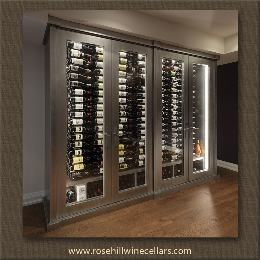 wine cellar with glass doors in house