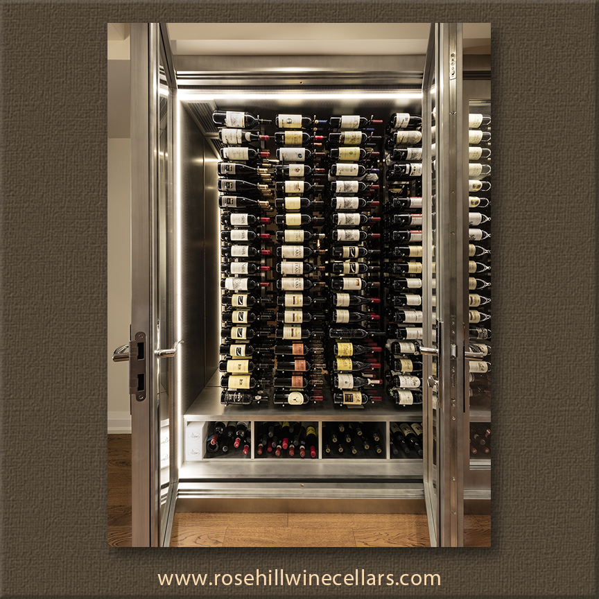double doors allow wine collector to access dozens on wine bottles