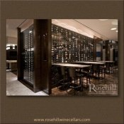 (19) Metal Wine Racking Display behind Glass