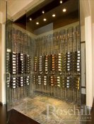 (18) Floor to Ceiling Mount Wine Racks in Front of Slate