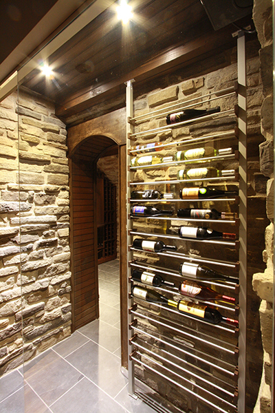 Millesime Wine Rack installed adjacent to stone wall